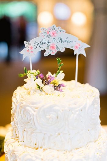 wedding cake with custom calligraphy topper