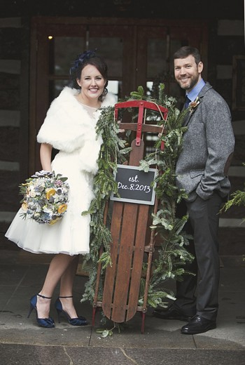 winter bride and groom with vintage sled