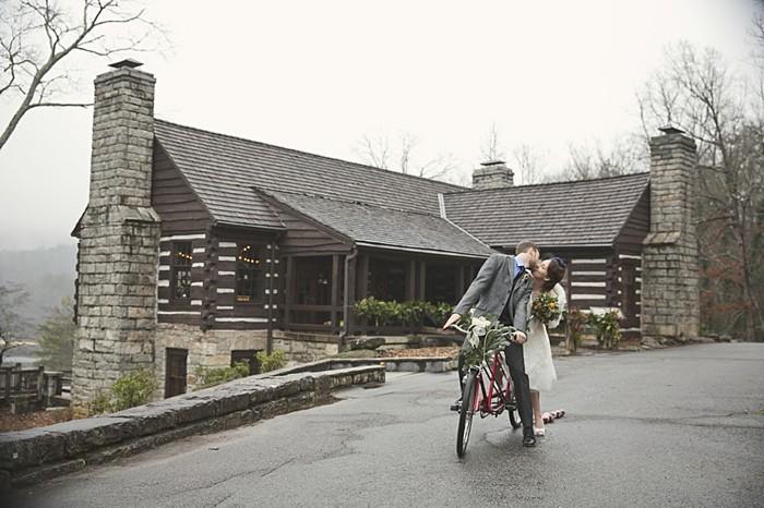 winter bride and groom on vintage bike