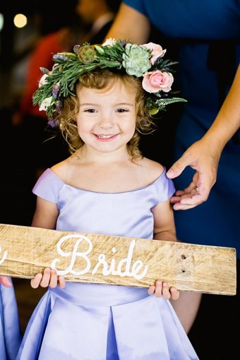 flower girl with wedding sign