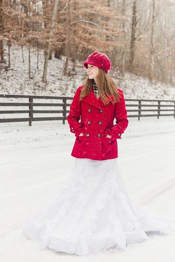 bride in red coat and red knit winter hat