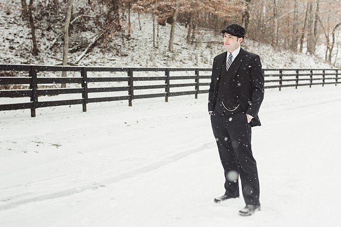 groom in a suit on a snowy day
