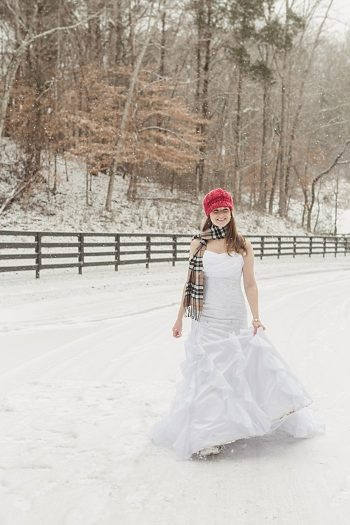 bride in plaid scarf and red kit winter hat