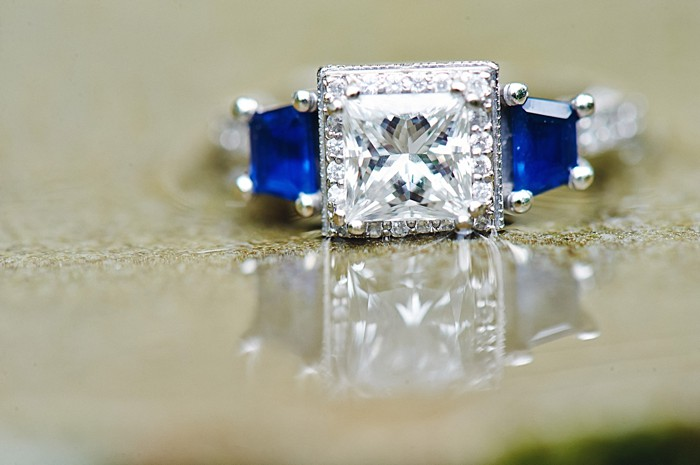 diamond engagement ring with sapphire accent