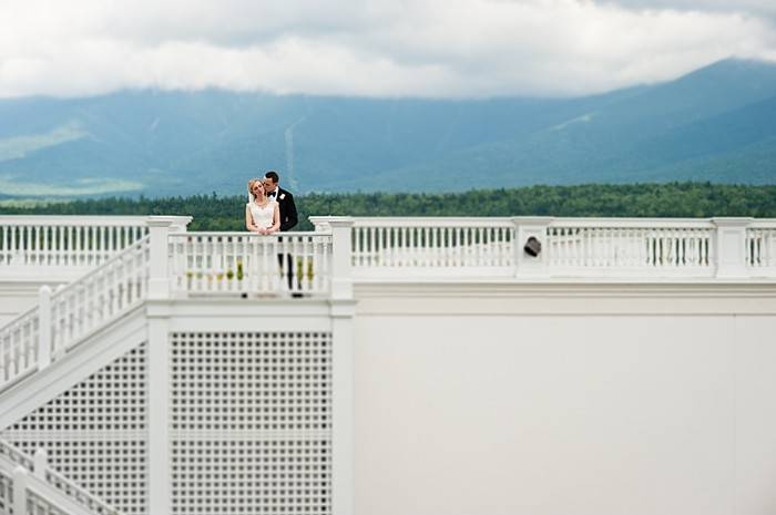 bride and groom on the deck | Photography by AMW Studios | see more on MountainsideBride.com