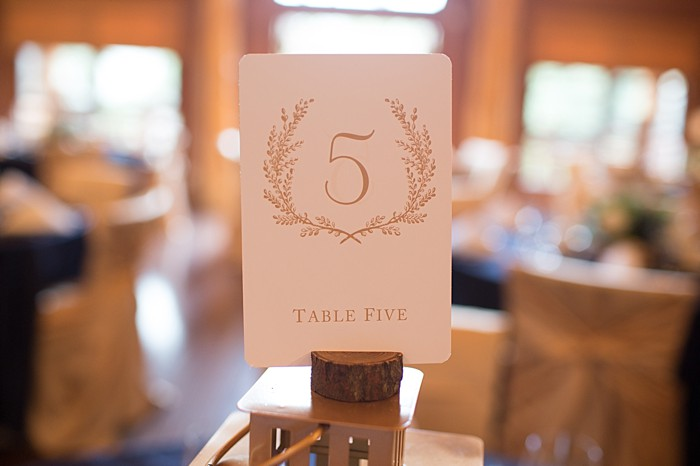 pretty laurel wreath table numbers | Banff Wedding by Just for You Photography