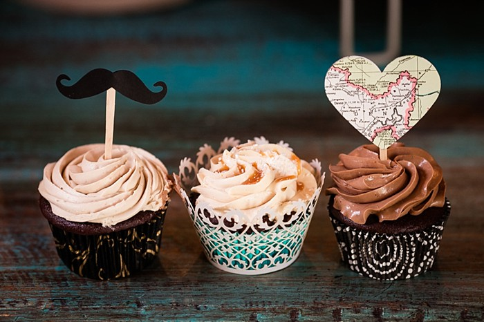 wedding cupcakes with laser cut wrappers and paper heart toppers western North Carolina handmade wedding by Shutter Love Photography