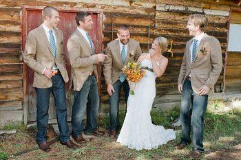 bride with groomsmen | steamboat springs wedding | Andy Barnhart
