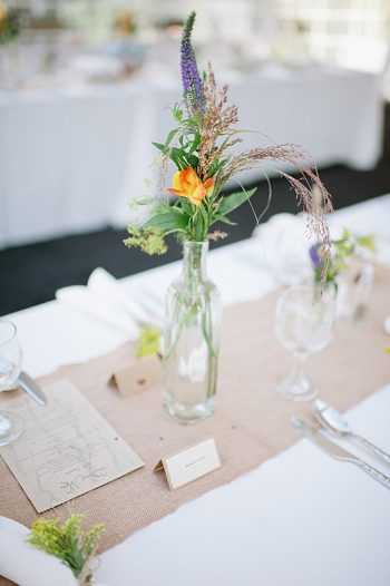 bottle flower centerpiece | steamboat springs wedding | Andy Barnhart