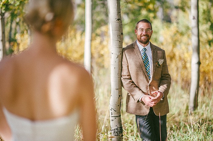 groom portrait in front of bride  | steamboat springs wedding | Andy Barnhart