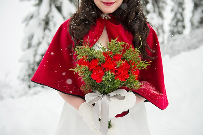 Red cape and bouquet | Emerald Lake winter elopement | Orange Girl