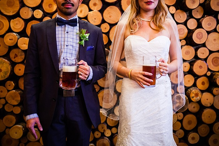 bride and groom with beer portraits | winter Revelstoke wedding | Christina Louise Photography