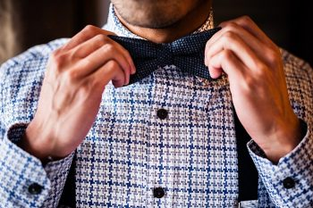 plaid shirt and bow tie | winter Revelstoke wedding | Christina Louise Photography