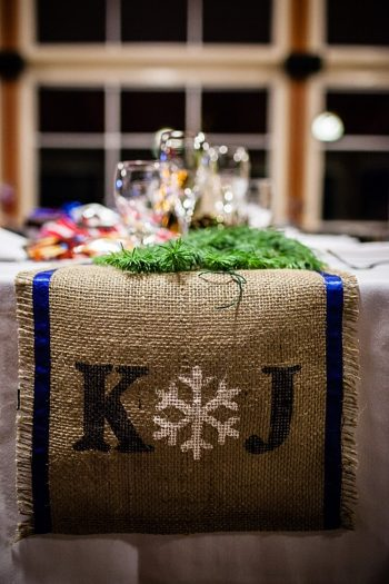 burlap runner with snowflake details | winter Revelstoke wedding | Christina Louise Photography