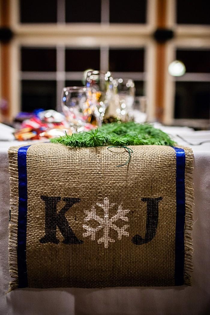 burlap runner with snowflake details | winter Revelstoke wedding | Christina Louise Photography