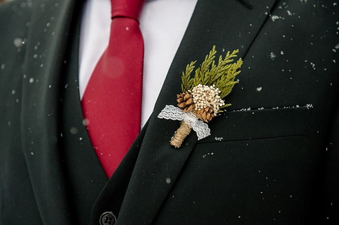 pine cone boutonnierre | Emerald Lake winter elopement | Orange Girl