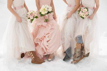 pink wedding gown with white bridesmaids dresses | Lake Louise winter wedding | Orange Girl photography