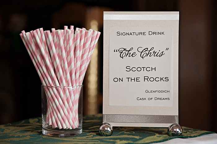 signature cocktail with pink and white paper straws | Lake Louise winter wedding | Orange Girl photography