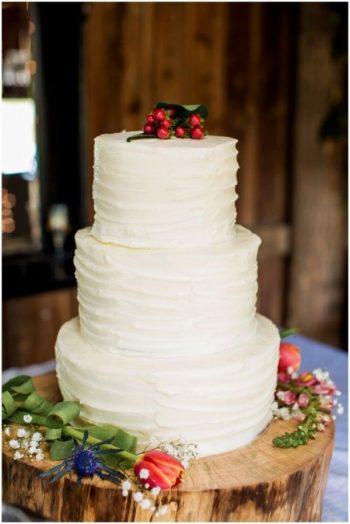 rustic wedding cake with cranberry topper | Via budget savvy bride