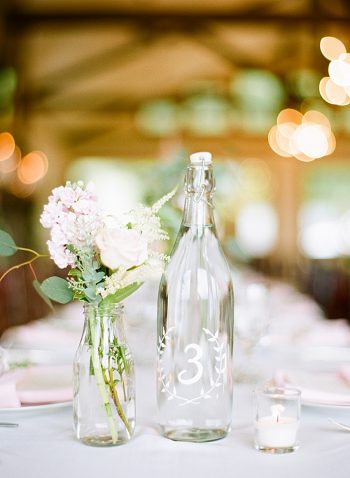 bottle table number ideas with romantic rose flowers | Estes Park Blush Pink Wedding | Photography by Connie Whitlock