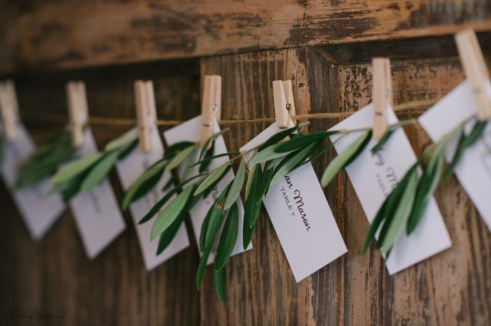 Pretty laurel leaf escort card ideas | Devils Thumb Wedding | Jordan Weiland Photography | Via MountainsideBride.com