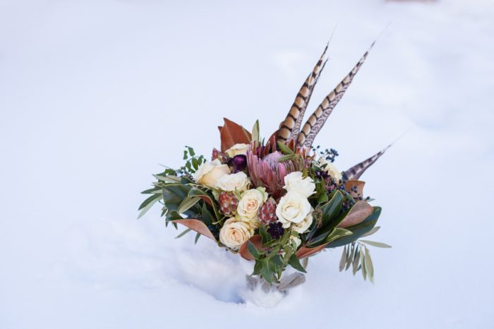 Pheasant feather bouquet | Breckenridge Nordic Wedding Inspiration Bergreen Photography | Via MountainsideBride.com