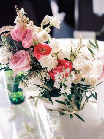 pink rose centerpieces   Copper Mountain Wedding Colorado Danielle DeFiore Photography   Via Mountainsidebride.com