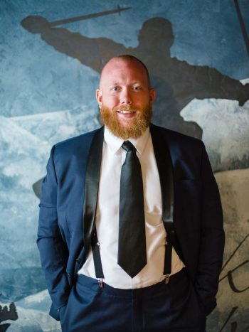 classic black suit   Copper Mountain Wedding Colorado Danielle DeFiore Photography   Via Mountainsidebride.com