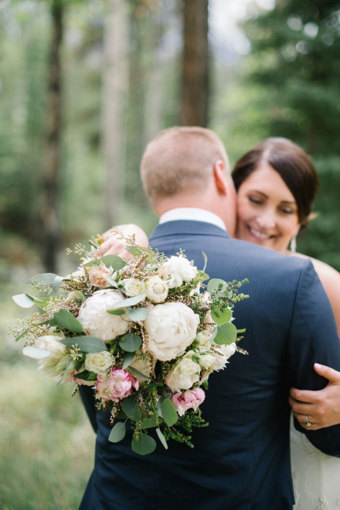 Bride Groom And Bouquet Canmore Mountain Wedding At Silvertip Resort Corrina Walker Photography | Via MountainsideBride.com
