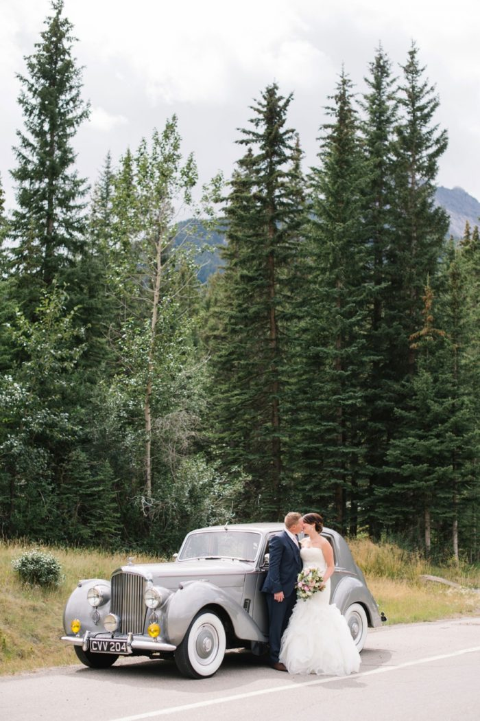 Vintage Car Canmore Mountain Wedding At Silvertip Resort Corrina Walker Photography | Via MountainsideBride.com