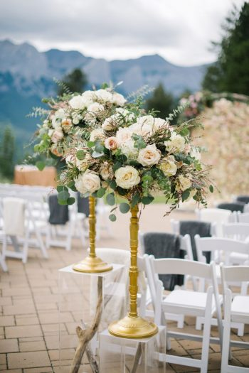 Ceremony Site With Gld And Rose Details Canmore Mountain Wedding At Silvertip Resort Corrina Walker Photography | Via MountainsideBride.com
