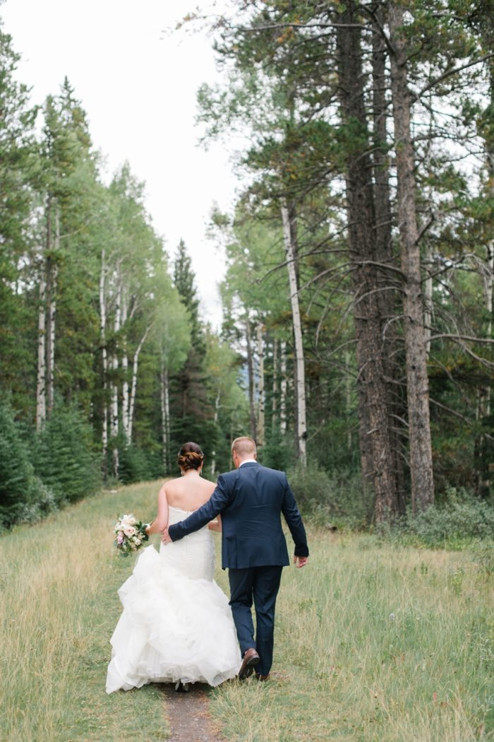 Bride And Groom In Woods Canmore Mountain Wedding At Silvertip Resort Corrina Walker Photography | Via MountainsideBride.com