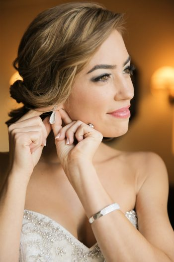 Bride Gettiing Ready | Elegant Park City Wedding St Regis Logan Walker Photography | Via MountainsideBride.com