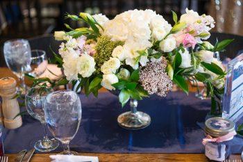 17 White Rose Centerpiece | Keystone Colorado Wedding Mathew Irving Photography | Via MountainsideBride.com