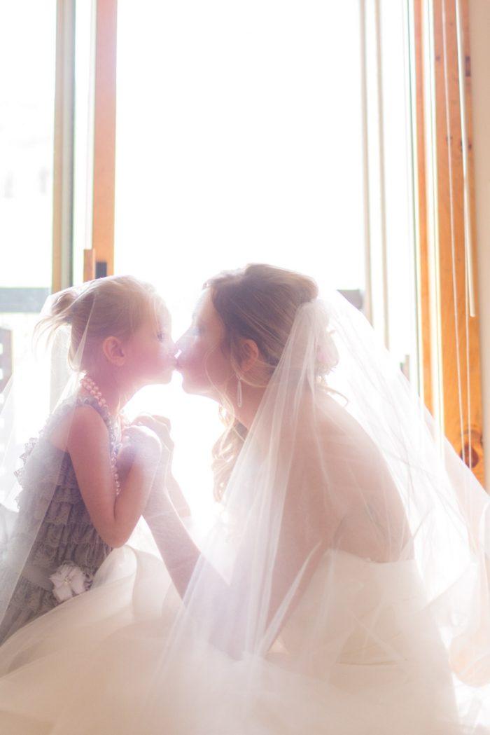 6 Flower Girl Kisses | Keystone Colorado Wedding Mathew Irving Photography | Via MountainsideBride.com