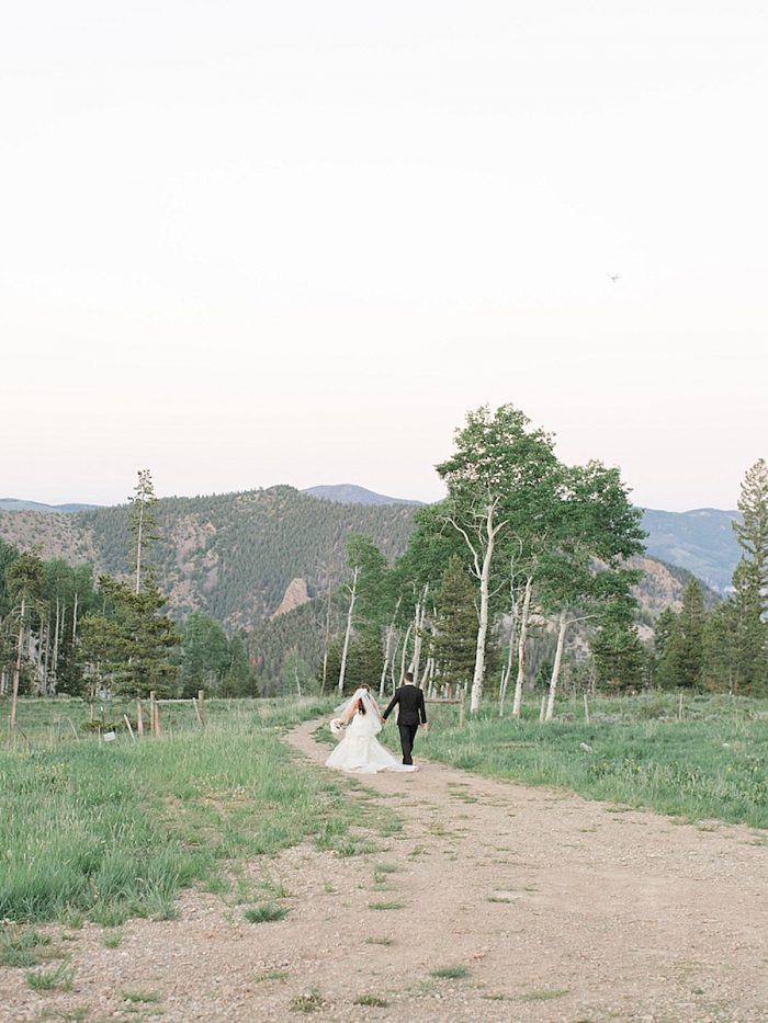 37 Bridegroom Scene Walk Silverthorne Colorado Wedding A Vintage Affair Via MountainsideBride.com
