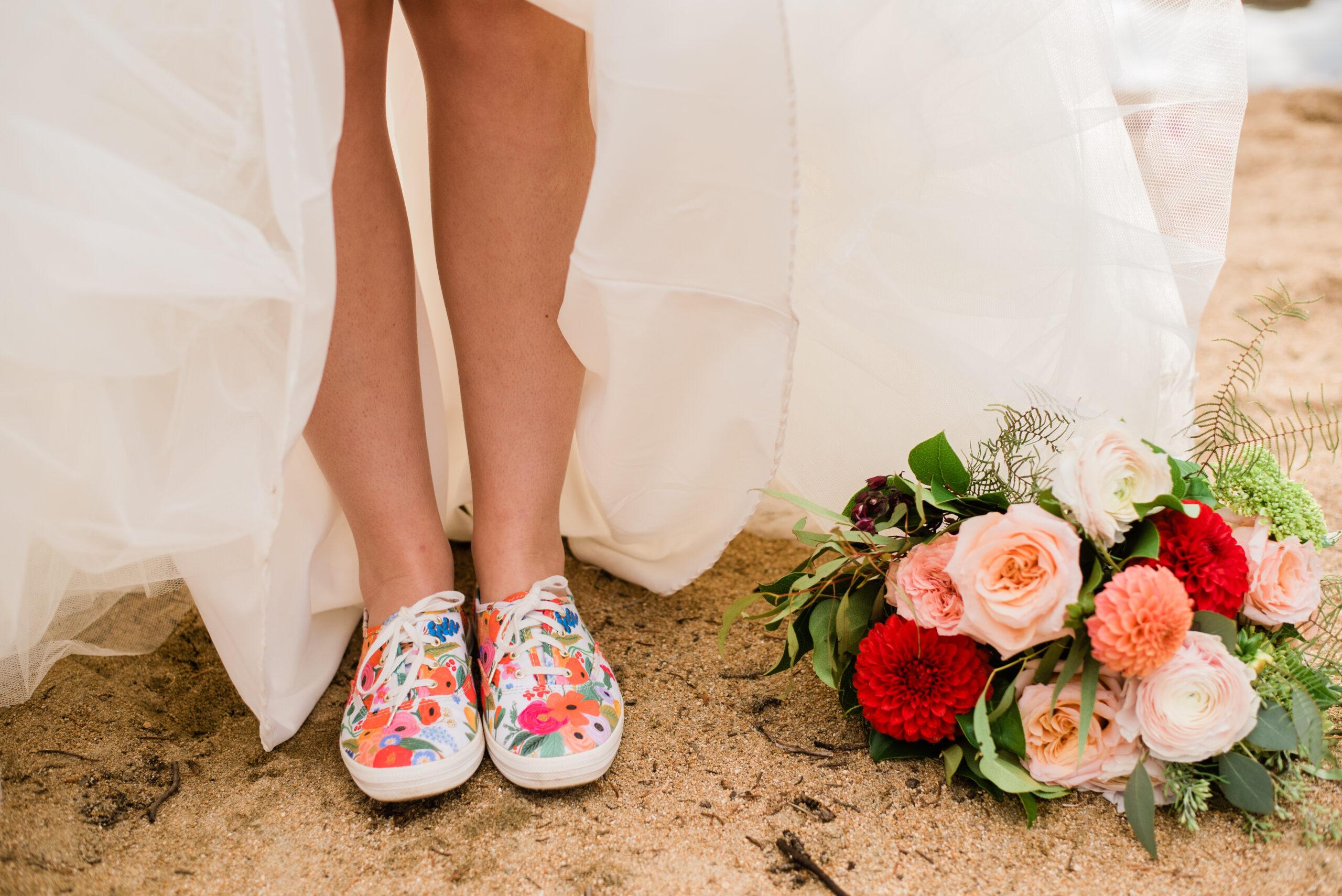 bride showing flower keds in her wedding dress