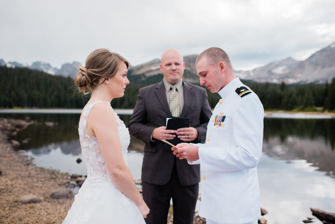 wedding ceremony by the lake with mountains in the background